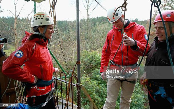 Catherine, Duchess of Cambridge watches as Prince William, Duke of Cambridge's support rope is adjusted as he abseils during a visit to Towers...