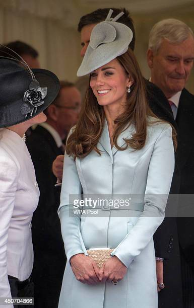 Catherine Duchess of Cambridge watches as Queen Elizabeth II leads the Knights of the Garter to the Most Noble Order of the Garter Ceremony from the...