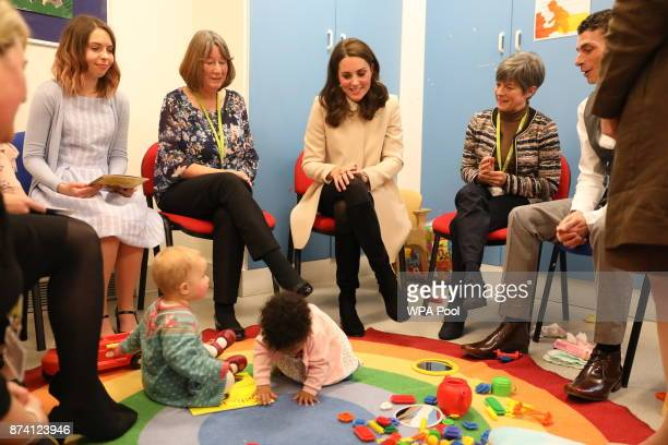 Catherine Duchess of Cambridge watches children play in the nursery with mothers and staff as she visits the Hornsey Road Children's Centre on...