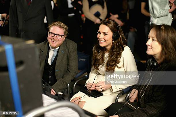 Catherine, Duchess of Cambridge watches live filming of a scene during an official visit to the set of Downton Abbey at Ealing Studios on March 12,...