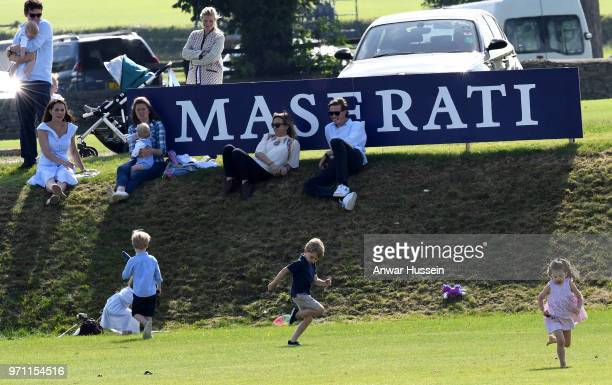 Catherine Duchess of Cambridge watches Prince George of Cambridge and Princess Charlotte of Cambridge as they play together during the Maserati Royal...