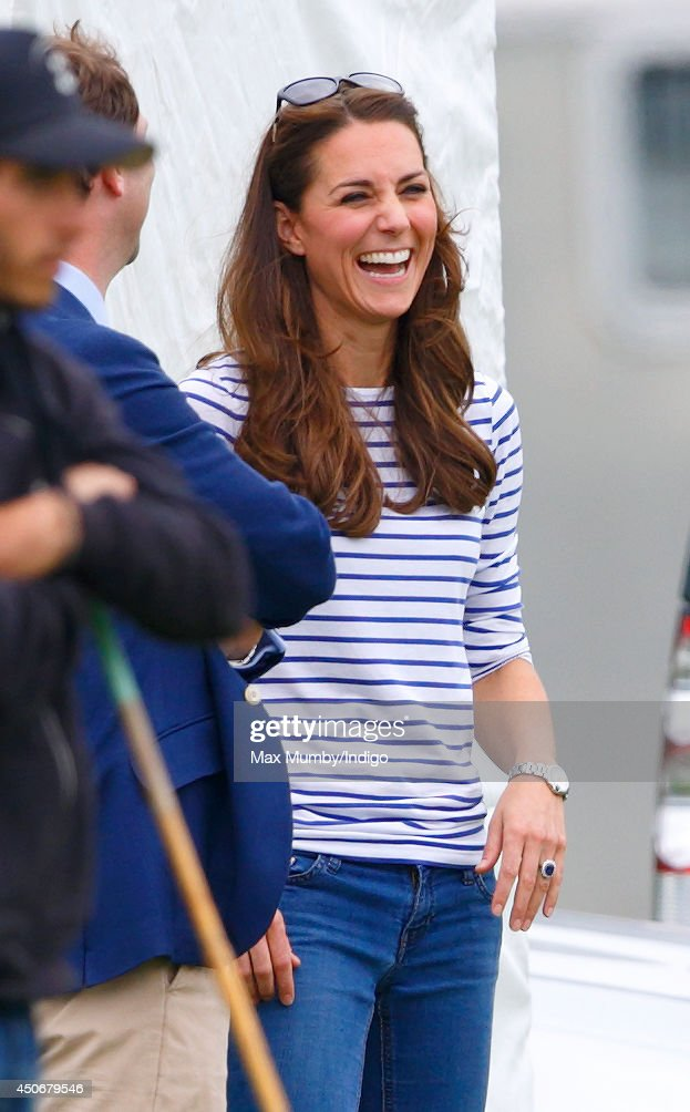 Catherine, Duchess of Cambridge watches Prince William, Duke of Cambridge & Prince Harry play in the Jerudong Trophy charity polo match at Cirencester Park Polo Club on June 15, 2014 in Cirencester, England.
