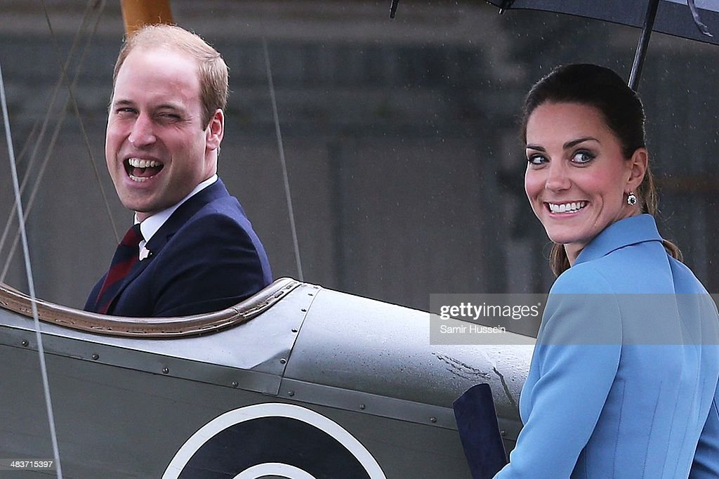 Catherine, Duchess of Cambridge watches Prince William, Duke of Cambridge sit in a plane as they attend a WW1 commemorative and Flying Day at Omaka Aviation Heritage Centre on April 10, 2014 in Blenheim, New Zealand. The Duke and Duchess of Cambridge are on a three-week tour of Australia and New Zealand, the first official trip overseas with their son, Prince George of Cambridge.