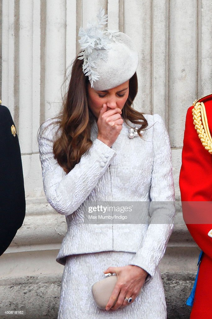 Catherine, Duchess of Cambridge watches the fly-past from the balcony of Buckingham Palace during Trooping the Colour, Queen Elizabeth II's Birthday Parade on June 14, 2014 in London, England.
