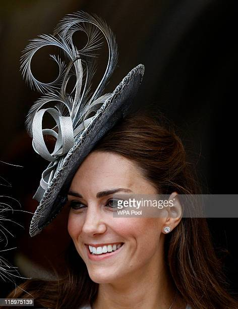 Catherine Duchess of Cambridge watches the Garter Service pass by on June 13 2011 in Windsor England The Order of the Garter is the senior and oldest...