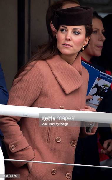 Catherine Duchess of Cambridge watches the racing as she attends Day 4 of The Cheltenham Festival at Cheltenham Racecourse on March 15 2013 in London...