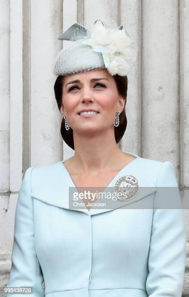 Catherine Duchess of Cambridge watches the RAF flypast on the balcony of Buckingham Palace as members of the Royal Family attend events to mark the...