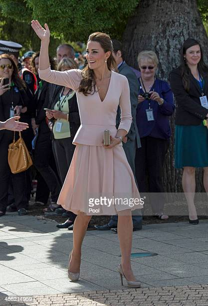 Catherine Duchess of Cambridge waves as she arrives at the Playford Civic Centre in the Adelaide suburb of Elizabeth on April 23 2014 in Adelaide...