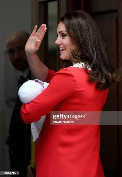 Catherine Duchess of Cambridge waves as she holds her newborn son Prince Louis of Cambridge at Lindo Wing at St Mary's Hospital on April 23 2018 in...