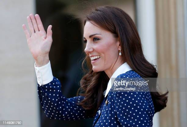 Catherine Duchess of Cambridge waves as she leaves after a visit to the DDay exhibition at Bletchley Park on May 14 2019 in Bletchley England The...