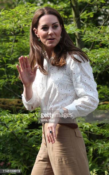 Catherine Duchess of Cambridge waves as she leaves after visiting her garden at the RHS Chelsea Flower Show at the Royal Hospital Chelsea on May 20...