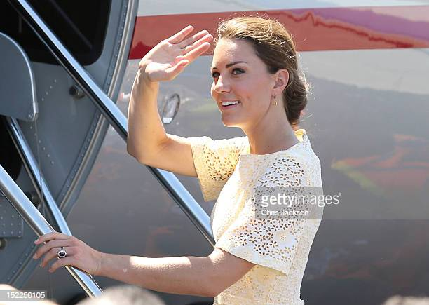 Catherine Duchess of Cambridge waves as she leaves Honiara International airport to head to Tuvalu on their Diamond Jubilee tour of the Far East on...