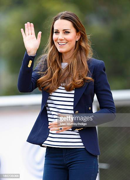 Catherine Duchess of Cambridge waves as she leaves the Copper Box Arena in the Queen Elizabeth Olympic Park after attending a SportsAid Athlete...