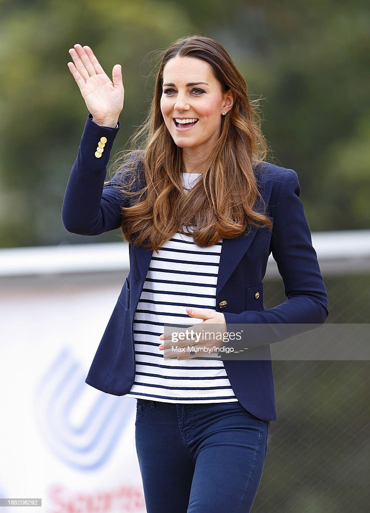 Catherine, Duchess of Cambridge waves as she leaves the Copper Box Arena in the Queen Elizabeth Olympic Park after attending a SportsAid Athlete Workshop on October 18, 2013 in London, England.