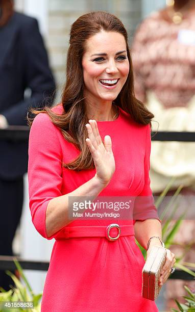 Catherine Duchess of Cambridge waves as she visits an MPACT Plus Counselling Programme at Blessed Sacrament School on July 1 2014 in London England