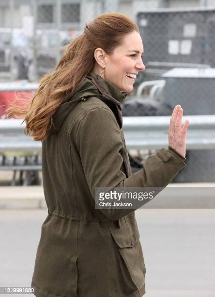 Catherine, Duchess of Cambridge waves as she visits the European Marine Energy Centre with Prince William, Duke of Cambridge on day five of their...