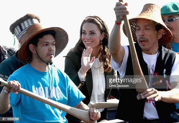 Catherine Duchess of Cambridge waves from a traditional canoe as she arrives at Skidegate Heritage Centre and Princess Charlotte are visiting Canada...