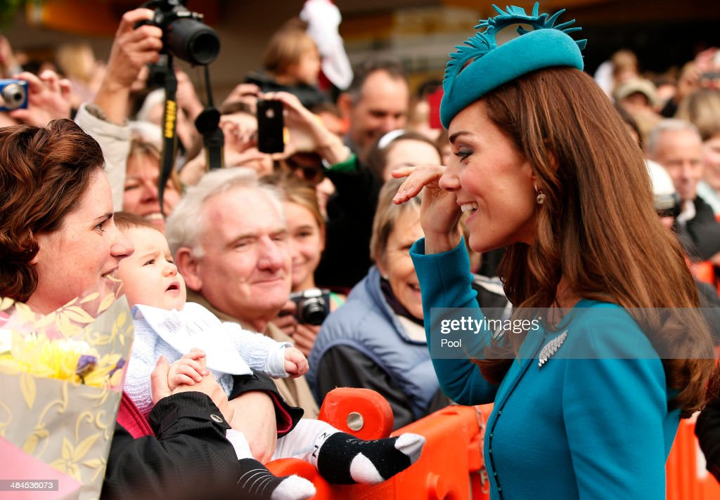 Catherine, Duchess of Cambridge waves to a baby after attending a Palm Sunday service at St. Paul's Anglican Cathedral on April 13, 2014 in Dunedin, New Zealand. The Duke and Duchess of Cambridge are on a three-week tour of Australia and New Zealand, the first official trip overseas with their son, Prince George of Cambridge.