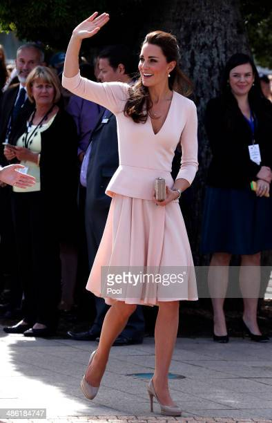 Catherine Duchess of Cambridge waves to members of the crowd as she arrives with her husband Prince William Duke of Cambridge at the Playford Civic...