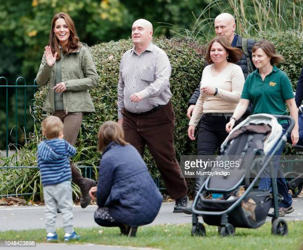 Catherine Duchess of Cambridge waves to members of the public as she visits Sayers Croft Forest School and Wildlife Garden on October 2 2018 in...