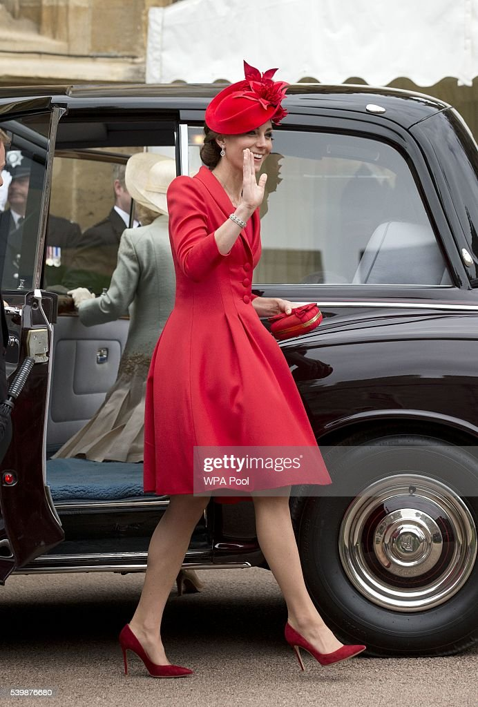 Catherine, Duchess of Cambridge waves to the crowd as she arrives for the Order of The Garter Service at Windsor Castle on June 13, 2016 in Windsor, England. The annual service is held in St George's Chapel at Windsor Castle.