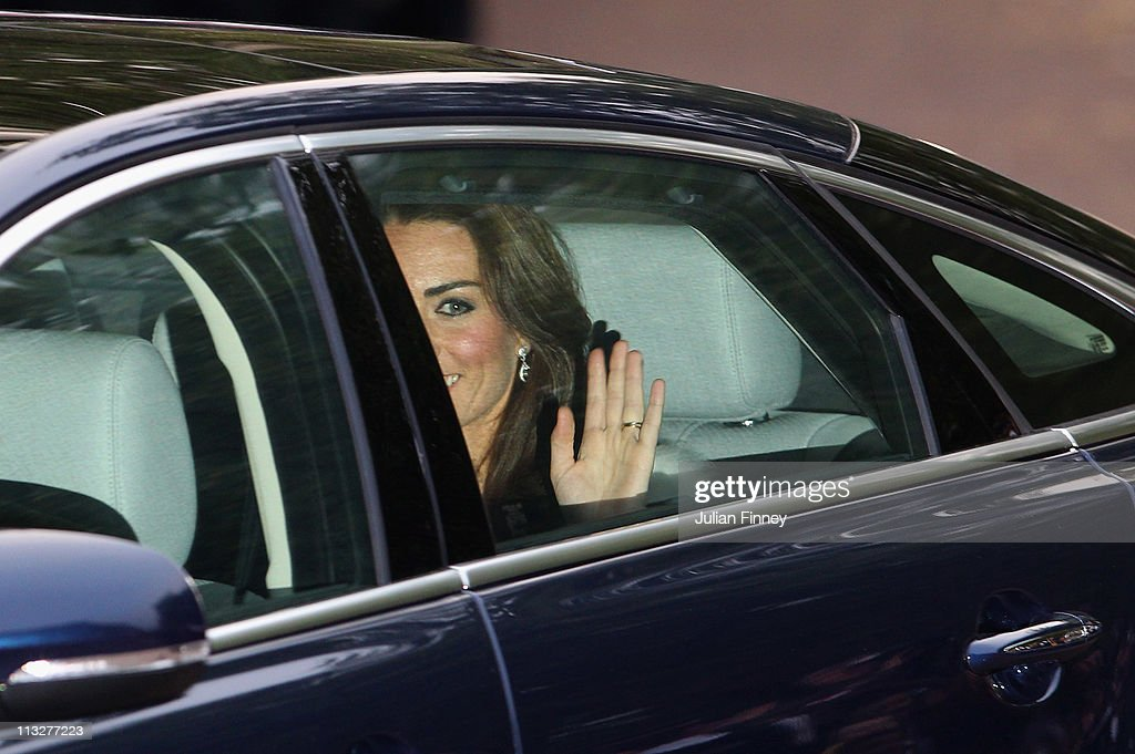 Catherine, Duchess of Cambridge waves to the crowd with (out of frame) TRH Prince William, Duke of Cambridge leaving Clarence House for the Evening Celebrations At Buckingham Palace on April 29, 2011 in London, England.