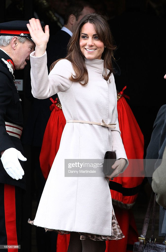 Catherine, Duchess of Cambridge waves to the crowds as she arrives at Cambridge Guildhall as she pays an official visit to Cambridge with Prince William, Duke of Cambridge on November 28, 2012 in Cambridge, England.
