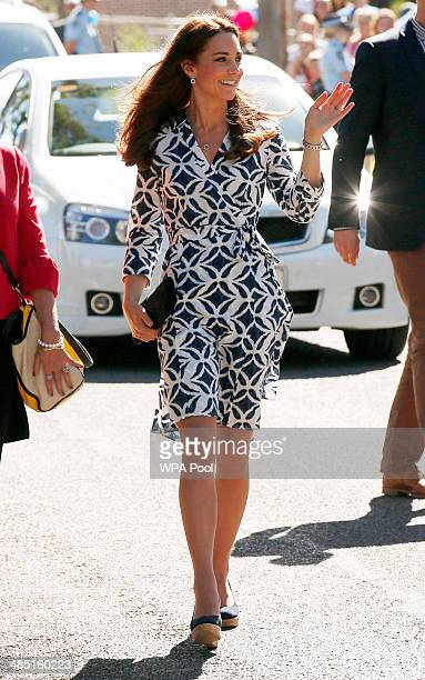 Catherine, Duchess of Cambridge waves to the public at the Blue Mountains suburb of Winmalee that lost homes during bushfires last year, on April 17,...