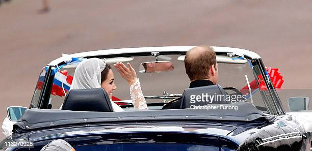Catherine Duchess of Cambridge waves to well wishers as she and Prince William Duke of Cambridge leave Buckingham Palace driving a convertible car on...