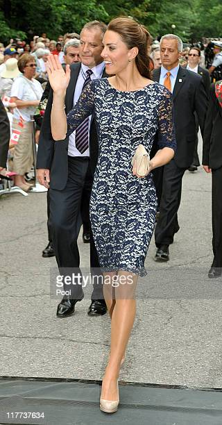 Catherine Duchess of Cambridge waves to wellwishers as she and Prince William Duke of Cambridge arrive outside the official residence of the Governor...