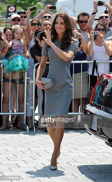 Catherine Duchess of Cambridge waves to wellwishers as she arrives at the Canadian War Muesum on July 2 2011 in Ottawa Canada Prince William Duke of...