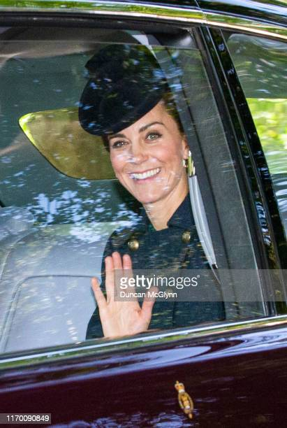 Catherine, Duchess of Cambridge waves while she is driven to Crathie Kirk Church before the service on August 25, 2019 in Crathie, Aberdeenshire....