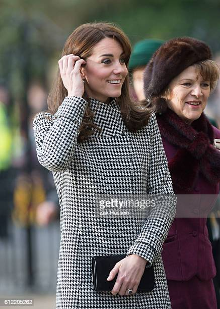 Catherine Duchess of Cambridge wearing a blue Emilia Wickstead dress and a Reiss coat visits Action on Addiction in Warminster WIltshire