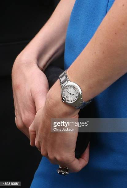 Catherine Duchess of Cambridge wearing a Cartier watch as she arrives for the opening of the ICAP Art Room at Northolt High School on February 14...