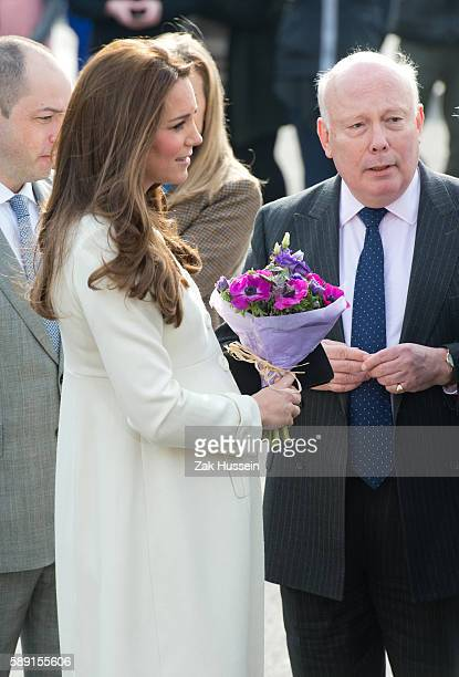 Catherine, Duchess of Cambridge, wearing a cream Jojo Maman Bebe maternity coat, meets Julian Fellowes as she visits cast and crew of Downton Abbey...