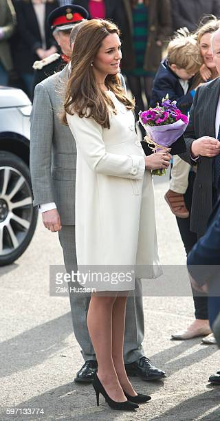 Catherine, Duchess of Cambridge, wearing a cream Jojo Maman Bebe maternity coat, visits cast and crew of Downton Abbey at Ealing Studios in London.