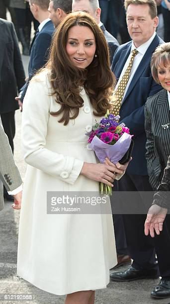 Catherine Duchess of Cambridge wearing a cream Jojo Maman Bebe maternity coat visits cast and crew of Downton Abbey at Ealing Studios in London