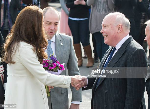 Catherine Duchess of Cambridge wearing a cream Jojo Maman Bebe maternity coat meets Julian Fellowes as she visits cast and crew of Downton Abbey at...