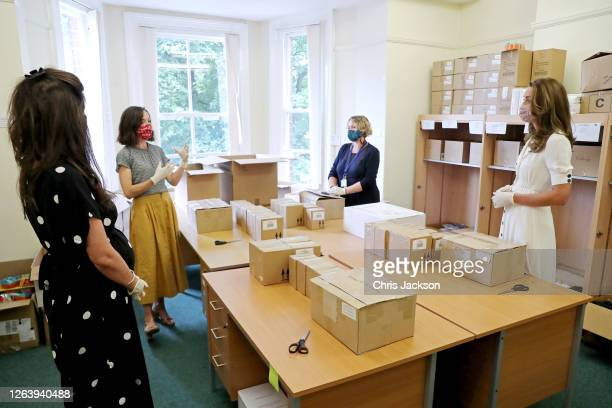 Catherine, Duchess of Cambridge, wearing a face mask, talks to Founder of Abernecessities Danielle Flecher-Horn, CEO Little Village Sophia Parker and...