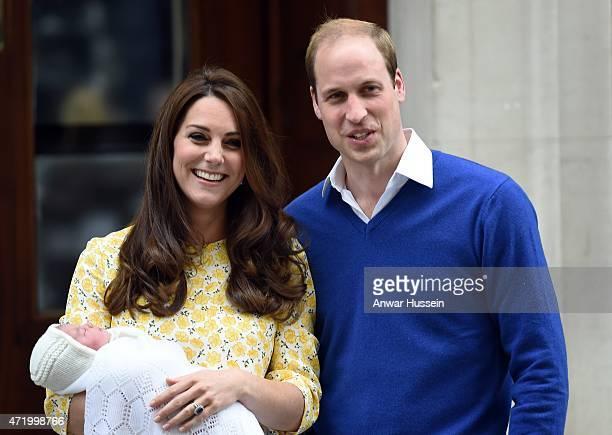 Catherine Duchess of Cambridge, wearing a Jenny Packham dress, and Prince William, Duke of Cambridge leave the Lindo Wing at St. Mary's Hospital with...