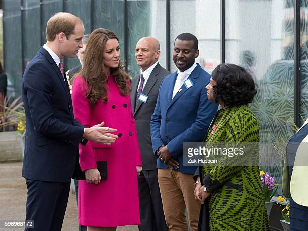 Catherine Duchess of Cambridge wearing a pink Mulberry coat and Prince William Duke of Cambridge visit the Stephen Lawrence Centre in South London