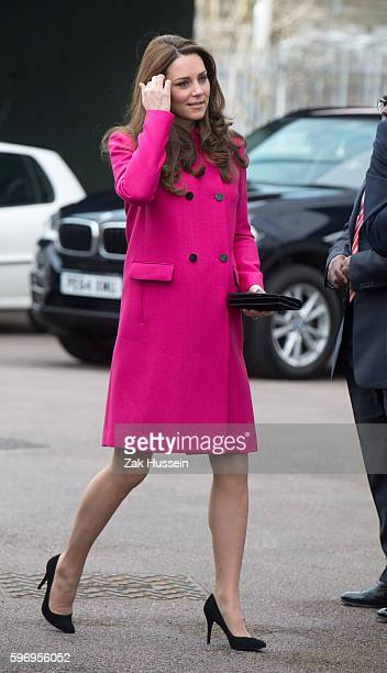 Catherine Duchess of Cambridge wearing a pink Mulberry coat visits the Stephen Lawrence Centre in South London