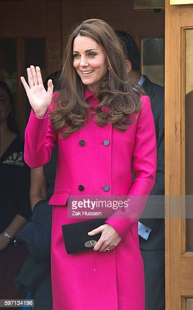 Catherine Duchess of Cambridge wearing a pink Mulberry coat visits South London
