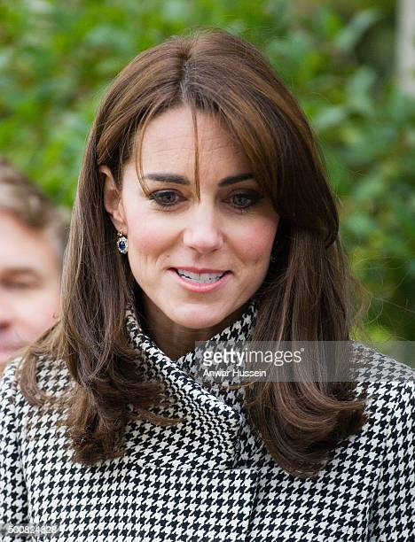 Catherine, Duchess of Cambridge, wearing a 'Rubik' coat by Reiss, attends an official visit to the Action on Addiction Centre for addiction treatment...