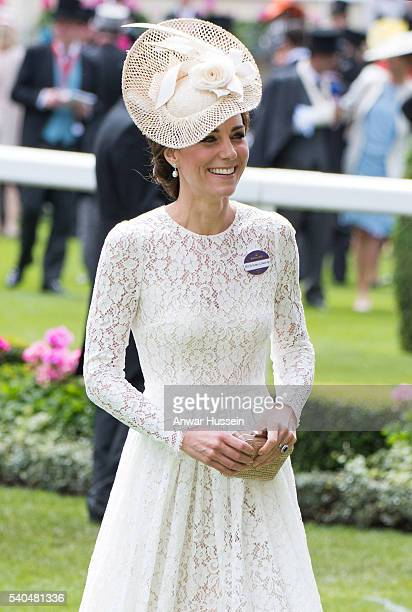 Catherine Duchess of Cambridge wearing a white lace Dolce Gabbana dress and a cream Jane Taylor hat attends Day 2 of Royal Ascot on June 15 2016 in...