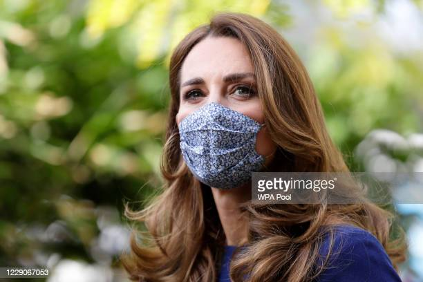 Catherine Duchess of Cambridge wears a face mask as she arrives to visit the Institute of Reproductive and Development Biology at Imperial College on...