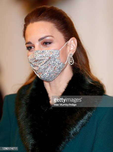 Catherine, Duchess of Cambridge wears a face mask as she attends an event to thank local volunteers and key workers from organisations and charities...