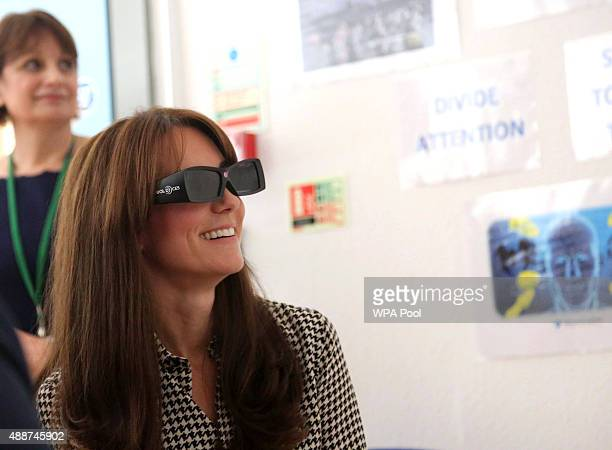 Catherine Duchess of Cambridge wears a pair of 3D glasses during a game which helps the children with discipline and coordination during a visit to...