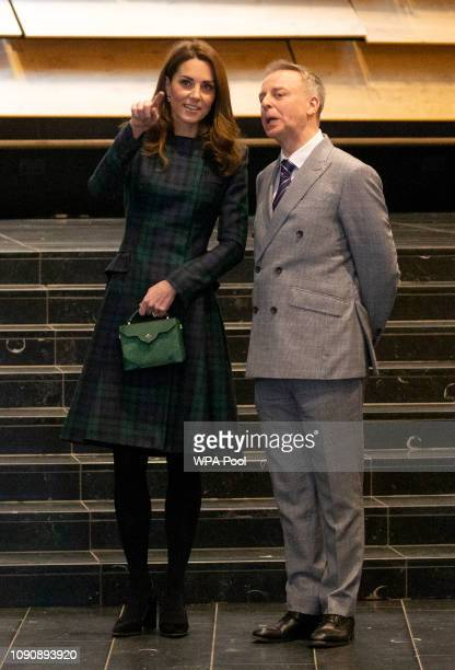 Catherine Duchess of Cambridge who is known as the Duchess of Strathearn in Scotland with museum director Philip Long during a visit to officially...