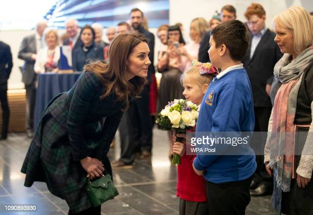 Catherine Duchess of Cambridge who is known as the Duchess of Strathearn in Scotland receives flowers from Debbie Gray from Rosebank Primary School...